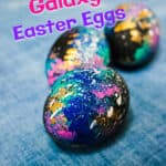 three galaxy Easter eggs on blue background