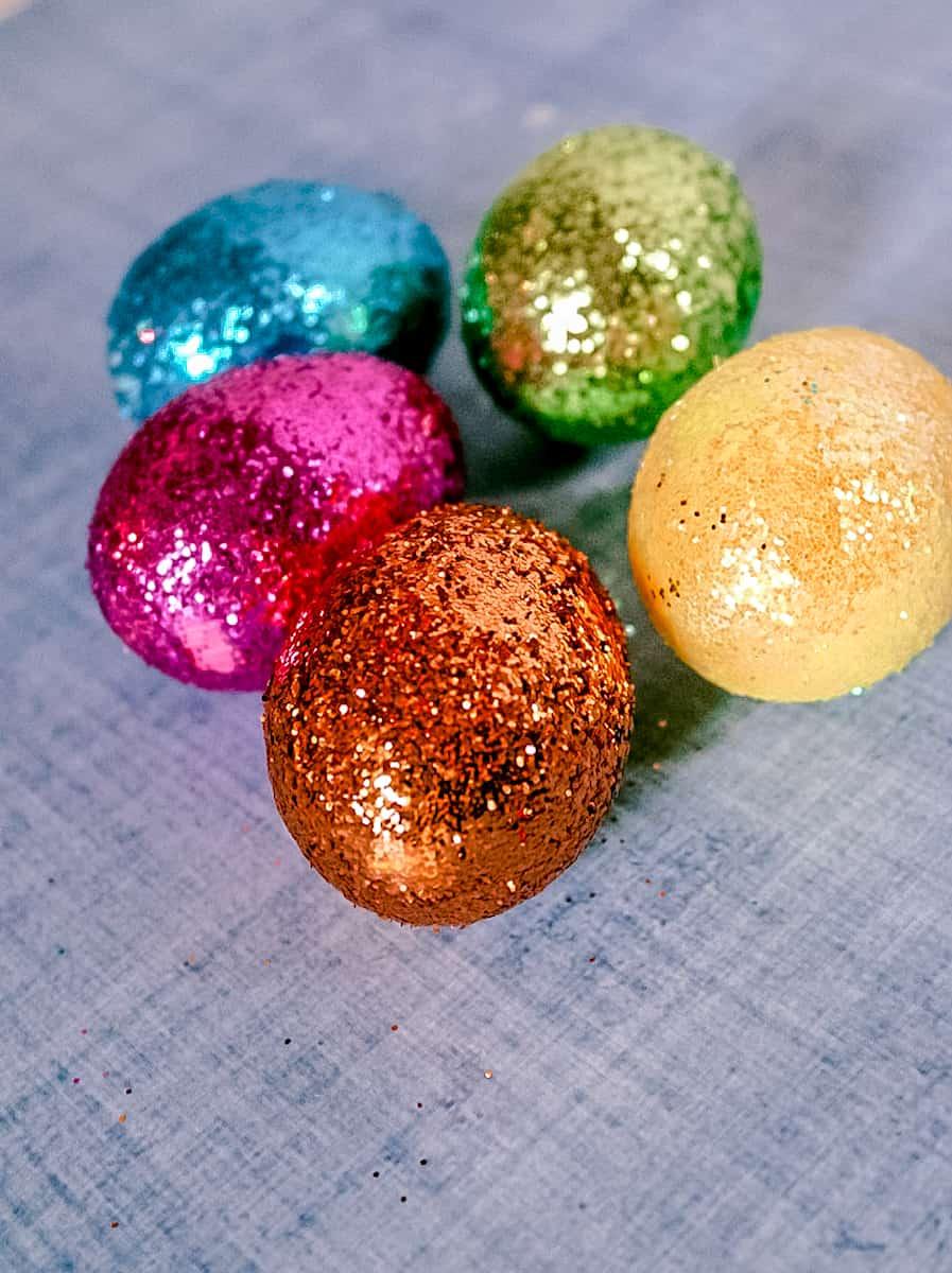 DIY Glitter Easter eggs cluster blue background
