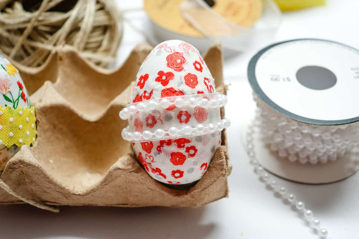 pearl ribbon around fabric covered egg