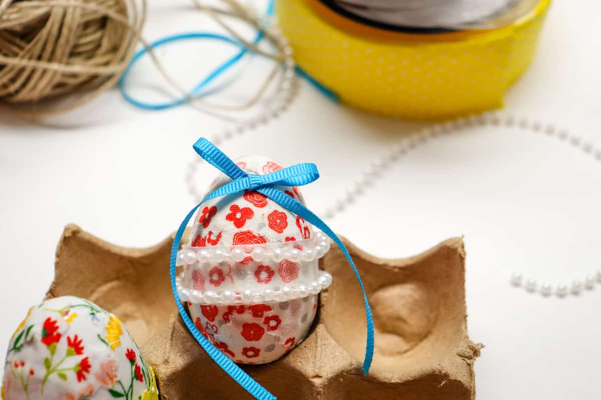 blue ribbon bow on fabric covered egg