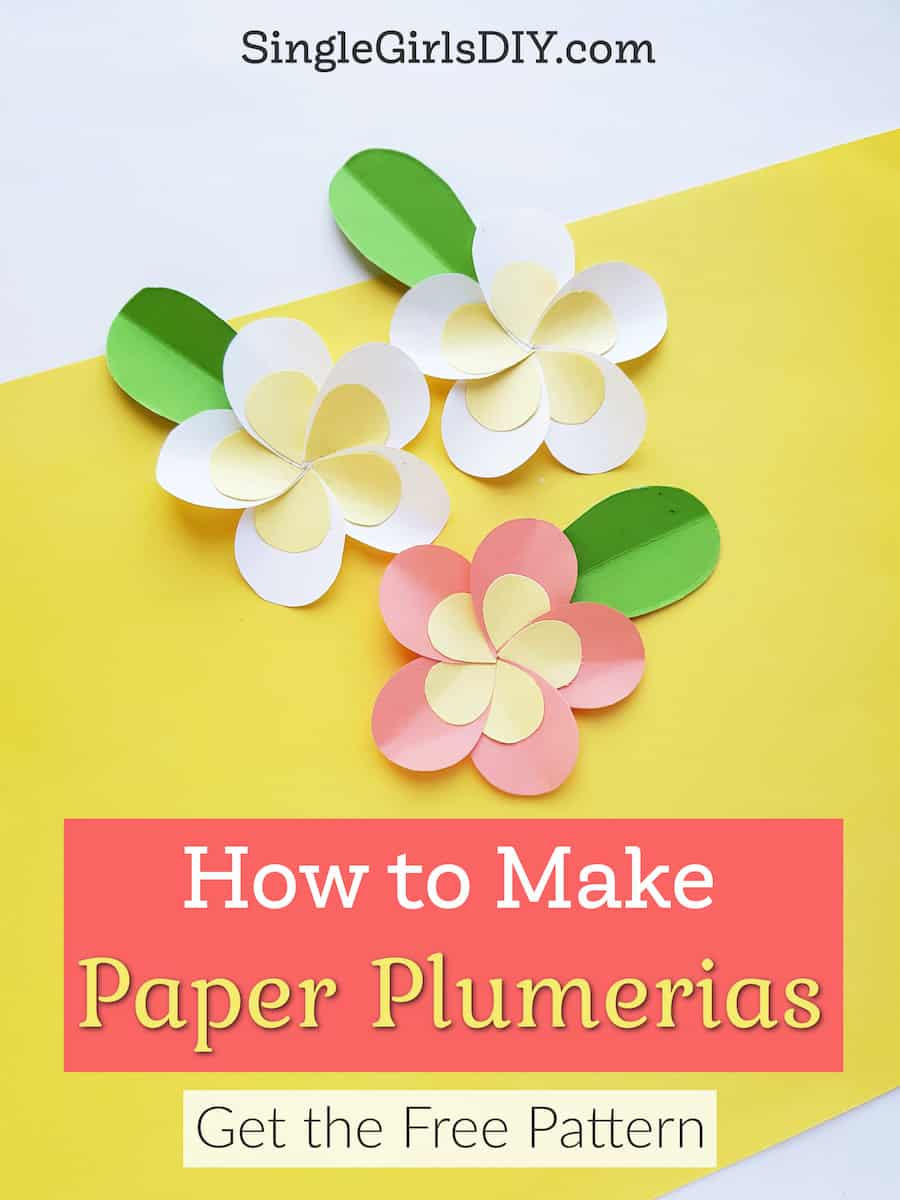 three colorful DIY paper plumerias on yellow background