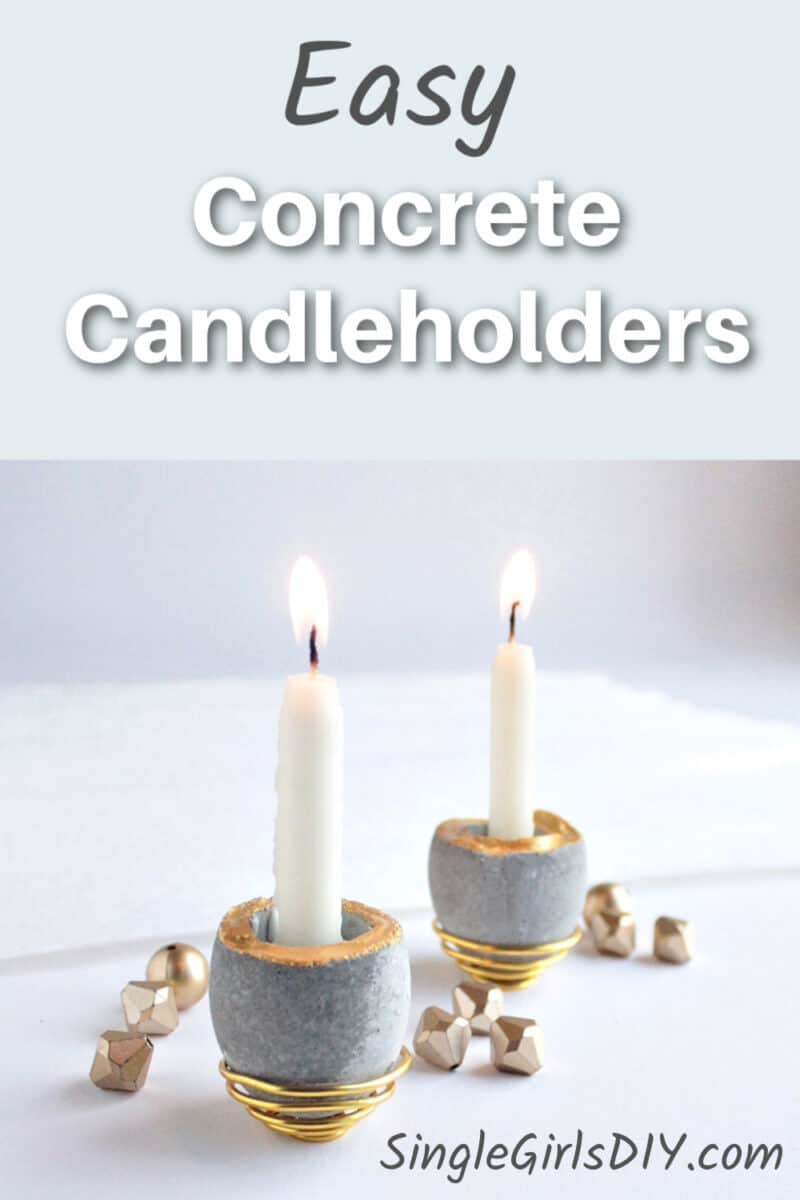 small cement candleholders with taper candles