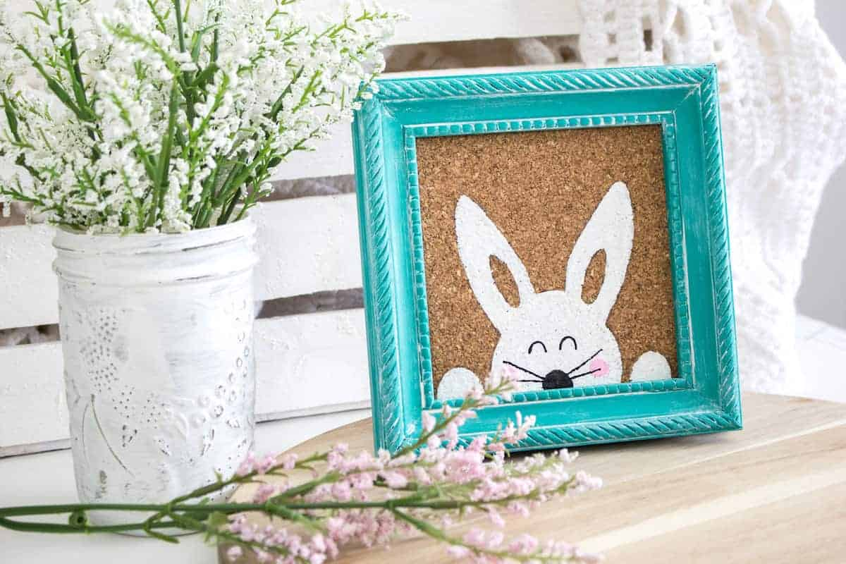 Stenciled Easter Bunny Art on table with vase of flowers