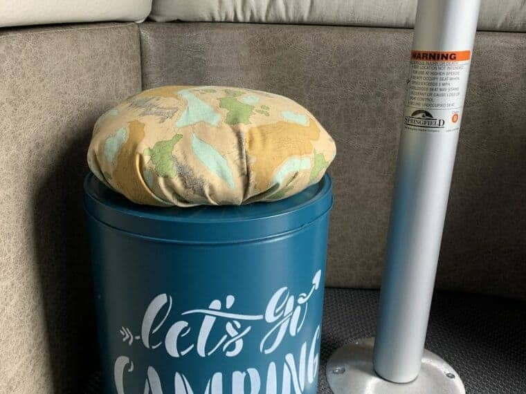diy popcorn tin storage container under RV table