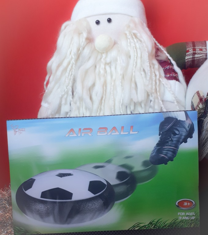 Air Ball box standing in front of a toy Santa
