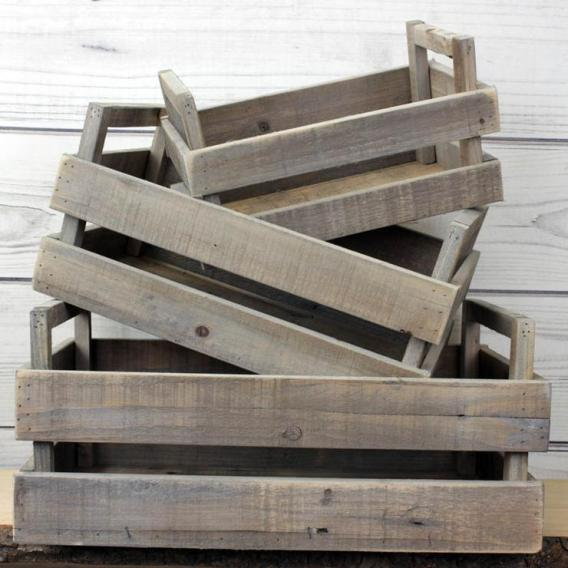 Three wooden rustic storage boxes piled on top of each other.