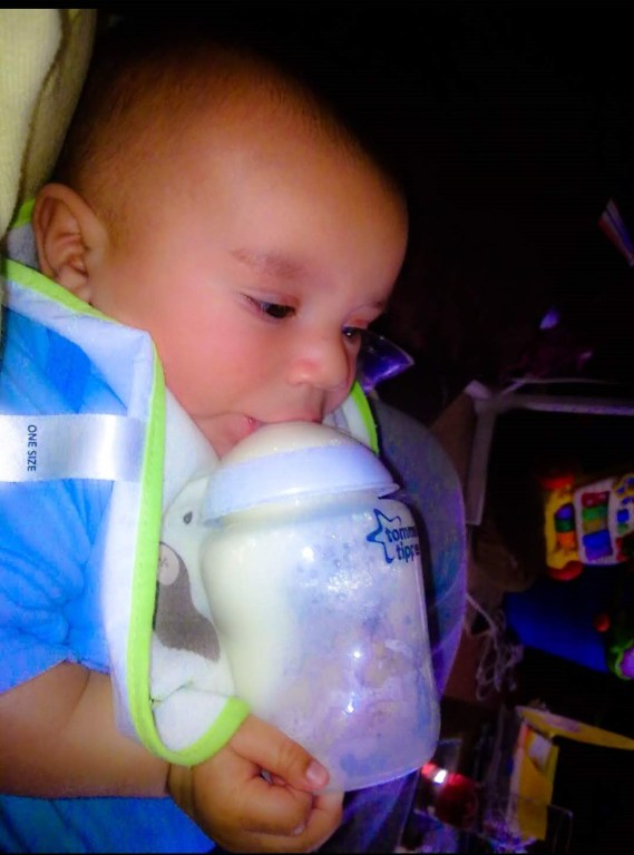 Baby drinking from a bottle.