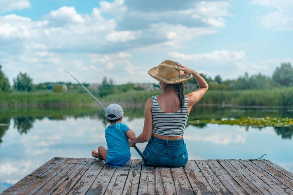 mum and son fishing at lake