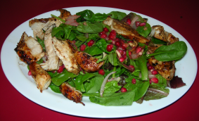 Spring Mix & Spinach with chicken and Pomegranate Dressing.