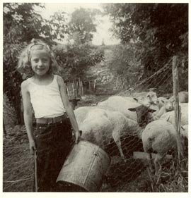 Carol at age 9 with my daddy's sheep