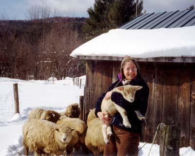 Carol Holding Lamb in Barnyard