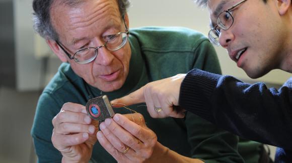 "Neuroengineers Arto Nurmikko and Min Ying, with their wireless ""brain radio"" [Source: Brown University]"