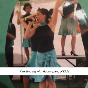 Kim singing with Accompany of Kids