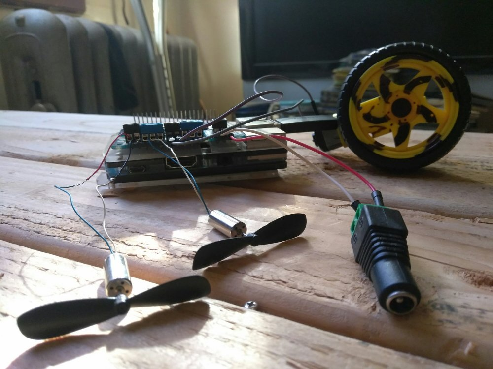 The Raspberry Pi/Adafruit Motor Shield configuration with some DC motors attached and ready to program!