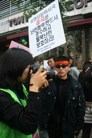 Shin Dong-hyuk, whose life story is told by Blaine Harden, protests the repatriation of North Korean defectors living in China   Image Courtesy: Dan Bielefeld