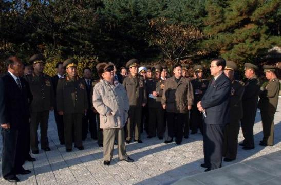 Two of the most powerful men in this photo have either died or been purged in the past year. North Korean leadership, however, still needs to peer up at China. | Photo from October 25, 2010, at pro-Chinese monument in South Pyong'an;  courtesy North Korea Leadership Watch