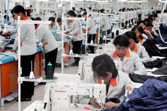 Cheap North Korean labor, strong South Korean chaebols make the Kaesong industrial an odd mix and sometimes uncomfortable relations.   Are South Korean industrial sewing machines and South Korean labor rights a start toward a secular awakening of the economic sense of valuing individuals? Image courtesy Wall Street Journal Korea Realtime blog