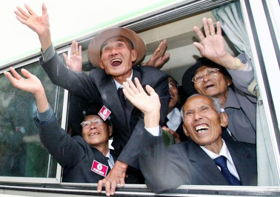 Ecstatic North Koreans wave to family after one of the most recent sets of family reunions, held in 2007 | image via USA Today