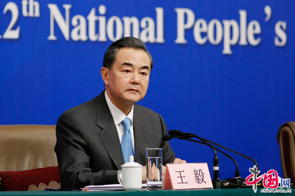 China's Foreign Minister Wang Yi takes questions at the National People's Congress in Beijing, March 8, 2013; image via Xinhua.