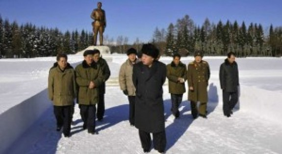 Kim Jong-un in Samjiyon, November 2013. His grandfather, Kim Il-sung, can be seen looking on from behind. | Image: KCNA