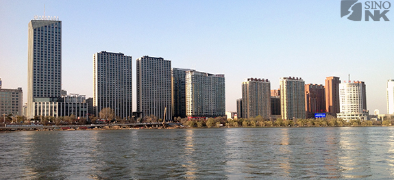 Jilin City from the banks of the Songhua River. The city is home to a significant number of legally resident North Koreans, and plays host to even more every April, when hundreds arrive by bus to attend events commemorating the birth  of Kim Il-sung. | Image: Steven Denney/Sino-NK