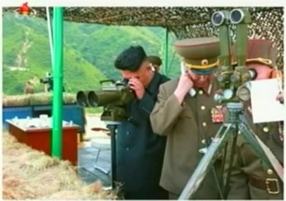 Hwang Pyong-so, on the phone, with Kim Jong-un at an artillery exercise in spring 2014. Image via Chosun Central TV.
