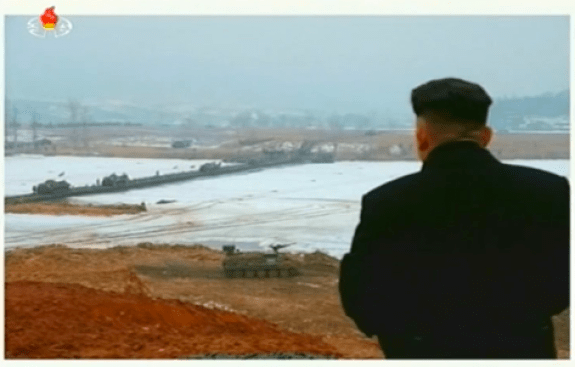Kim Jong-un watches General Hyon lead tank exercises prior to the purge. Image via Chosun Central Television