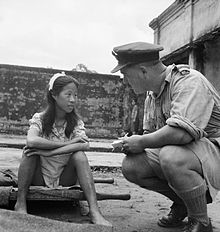 "As per the description, ""Rangoon, Burma. August 8, 1945. A young ethnic Chinese woman who was in one of the Imperial Japanese Army's ""comfort battalions"" is interviewed by an Allied officer."" 