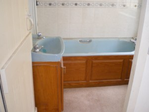 Before - a dated bathroom in need of refurbishment