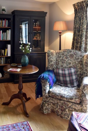 Wing back chair in country sitting room