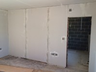 Plasterboard walls installed after first fix electrics