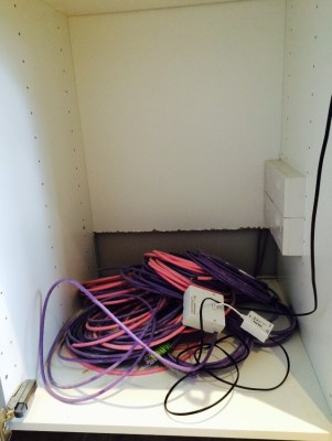 The 'coms' cupboard with a 'spaghetti' of wires eating for connection to Sonos System