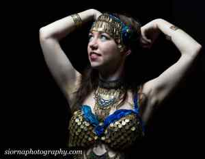 A gypsey romany dancer in a custom blue and gold outfit and headband. This photograph is from a portrait session in Islington and Haringay. Photograph by Siorna Ashby, a portrait photographer in north London, Finsbury Park.