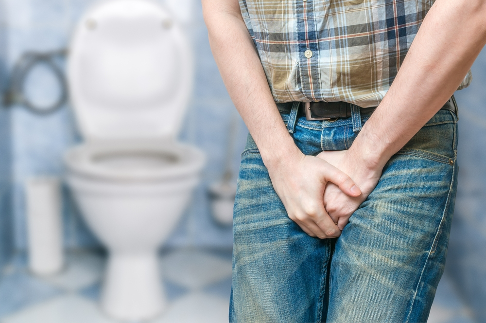 man holding his bladder, he needs to urgently pee