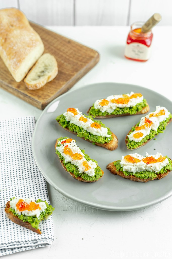 Pea Pesto Crostini with Ricotta and Red Pepper Jelly | Sip and Spice