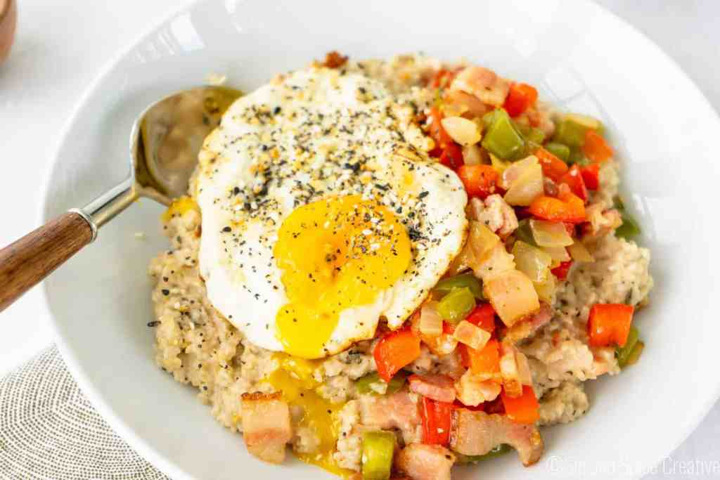 Savory Oatmeal with a Fried Egg and Bacon | Sip and Spice
