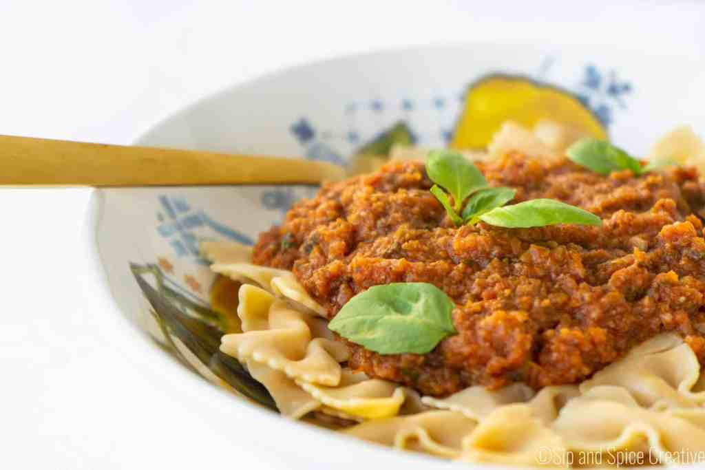 Eye Level Veggie Bolognese with Fresh Basil on Chickpea Pasta | Sip and Spice