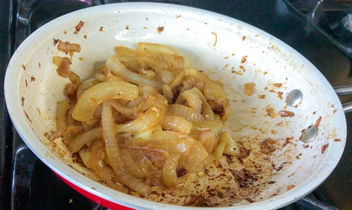 final step finishing caramelized sous vide onions on the stove in a pan