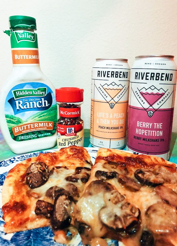 Homemade pizza with Trader joes pizza dough hidden valley ranch dressing crushed red pepper and riverbend IPA