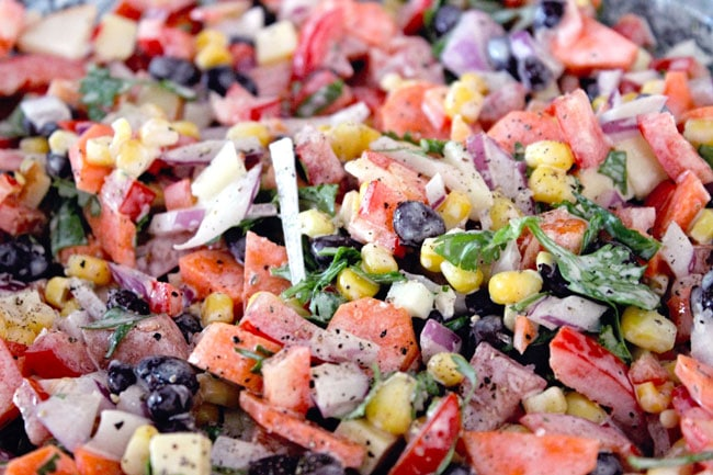 close up of ingredients for make ahead Mexican salad with ranch dressing for a BBQ or potluck