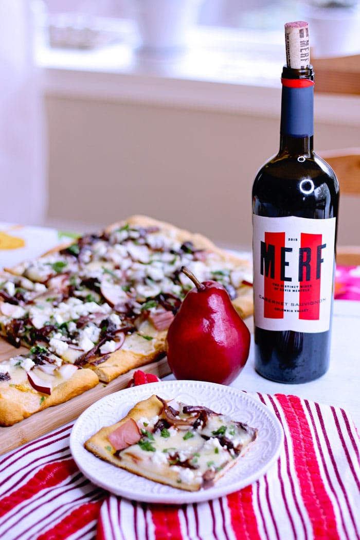Merf wine cabernet sauvignon onions on pear and goat cheese flatbread topped with caramelized onions, ham and cheddar