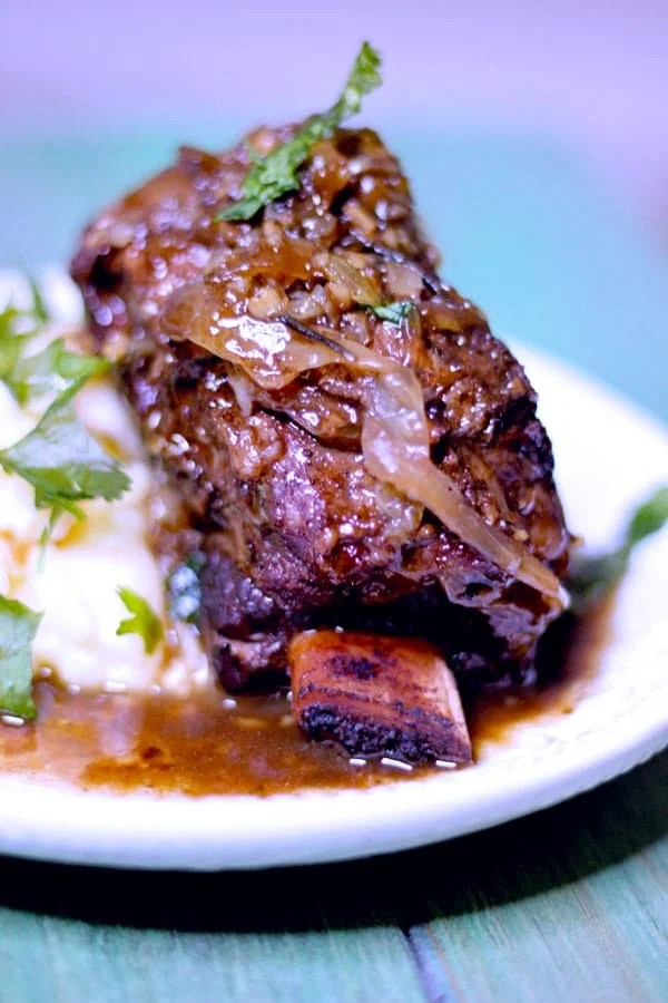 sous vide short ribs 24 hours with mashed potatoes on a green table