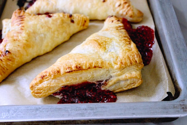 Fresh raspberry puff pastry turnovers