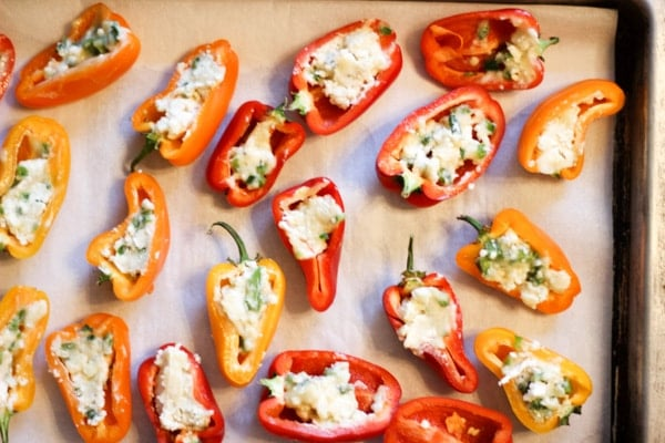sheet tray at a party with stuffed mini sweet peppers