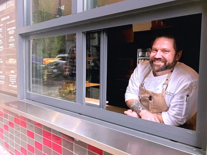 Chef AJ outside the Porter Hotel in Portland at Chiosco's pizza window