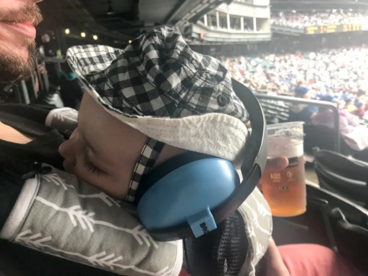 baby at baseball game
