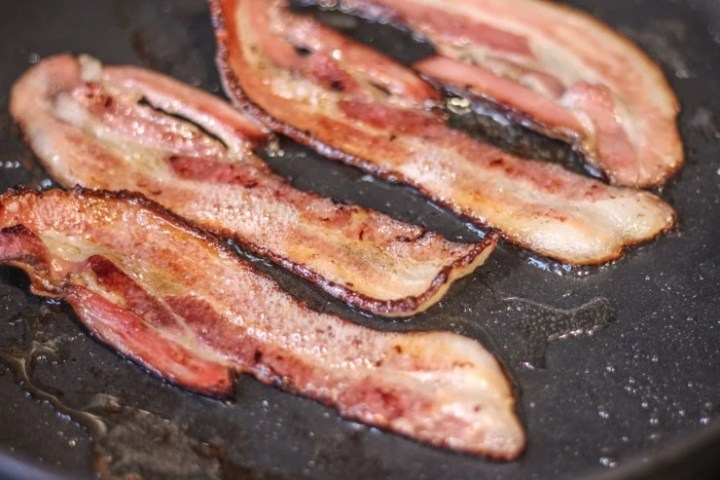 cooking sous vide bacon in a cast iron pan on medium-high to get a crispy finish