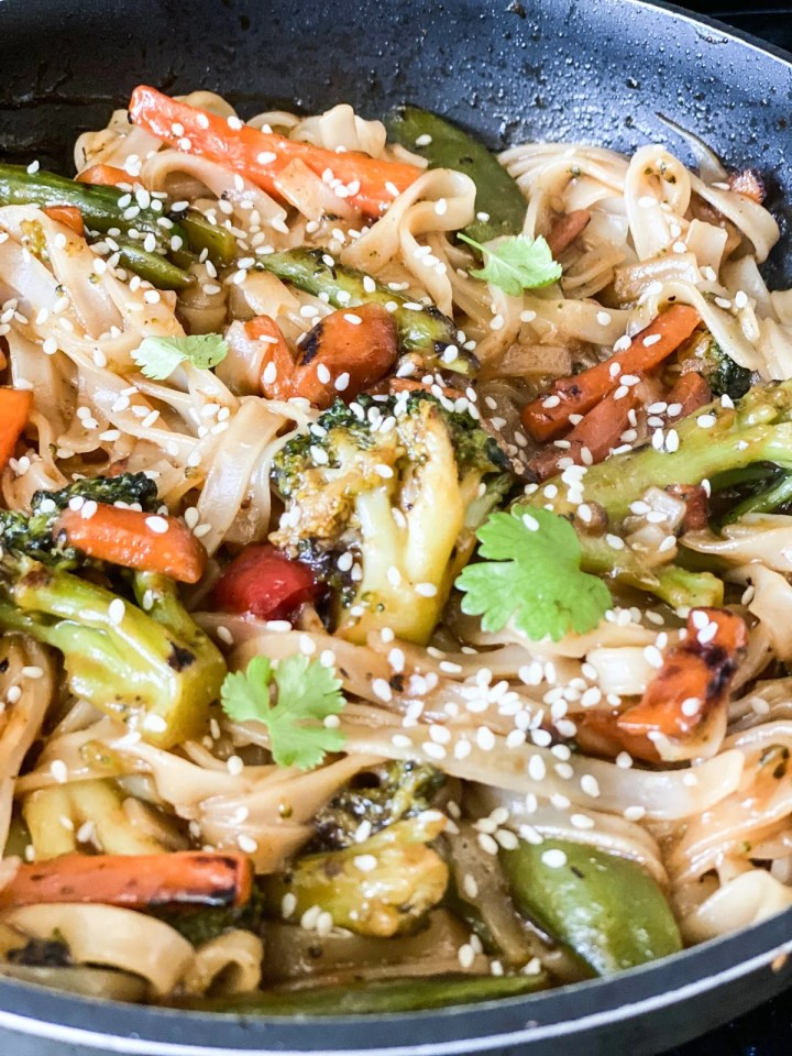 stir fry topped with sesame seeds and cilantro