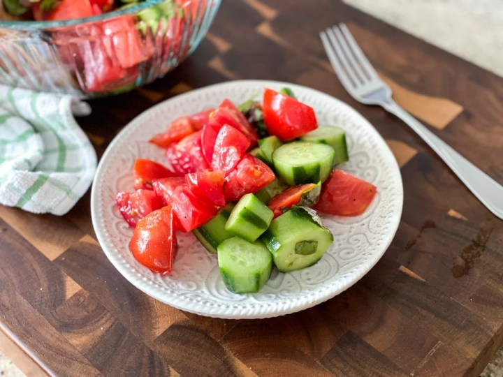 serving a simple tomato cucumber salad with white wine vinegar
