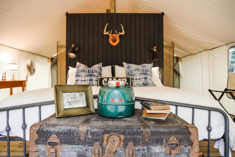 Inside of Glamorous Tent with King Bed Vintage Details